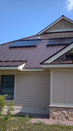 Solar domestic hot water on Sunrise Acres unit roof.