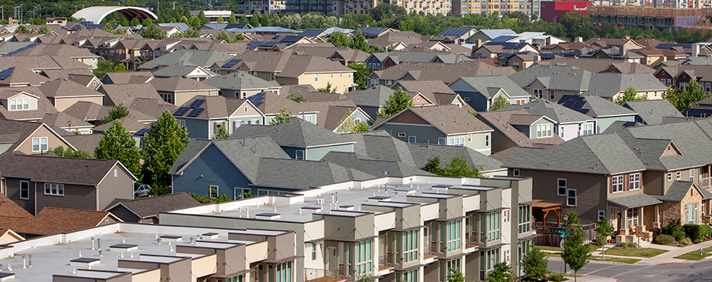 An aerial view of houses in a residential neighborhood.