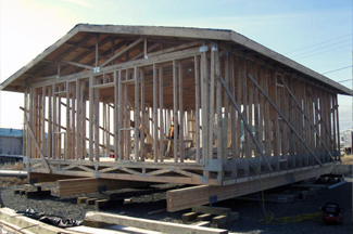 The integrated truss includes roof, walls, and floor.