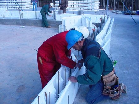 Image of workers constructing the reinforced ICF walls.