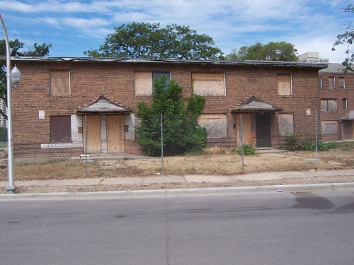 Image of the Madden/Wells Homes as they appeared in 2005 before demolition.