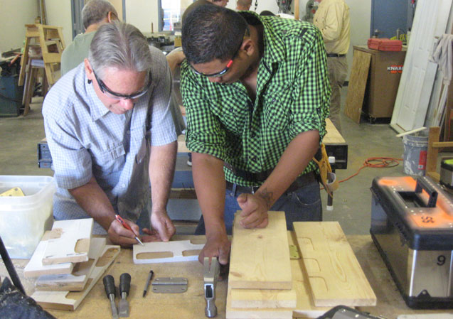 Image of instructor demonstrating proper layout and prepping material to mortise hinges.