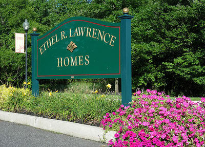 The Ethel R. Lawrence Homes entrance sign is located along the community entrance.