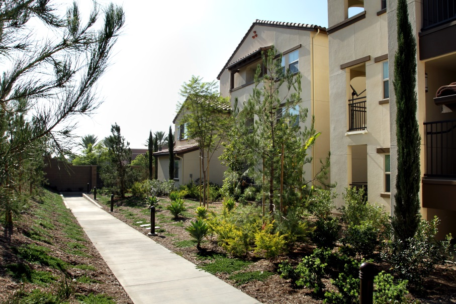 Doria Apartments Adds To Irvine S Housing Spectrum Photograph Of A Three Story Building With Stucco Walls And Terracotta Roof Numerous