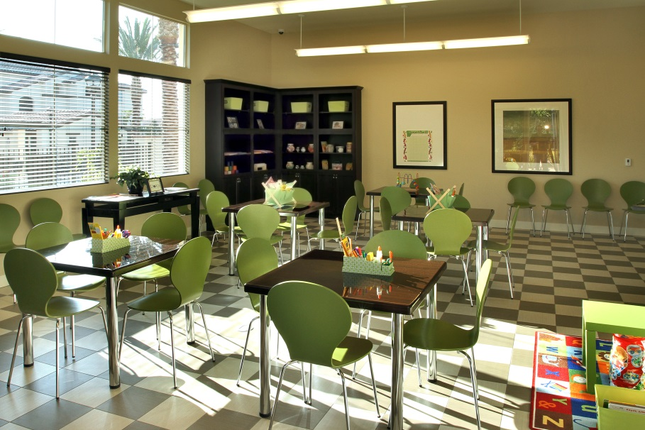 Photograph Of A Room With Five Work Tables And Four Chairs At Each Table Among Doria Apartments