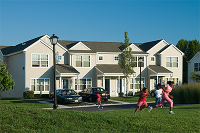 Children running on the grounds of Ethel R. Lawrence Homes in Mount Laurel Township, New Jersey.