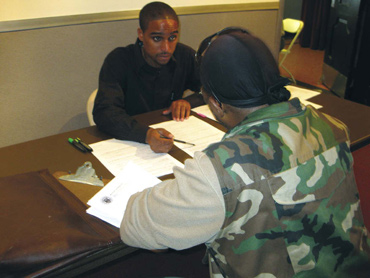 A homeless veteran is interviewed for a HUD-VASH voucher.