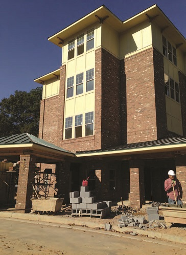A foreclosed apartment building in the process of redevelopment as a 42-unit senior living facility.