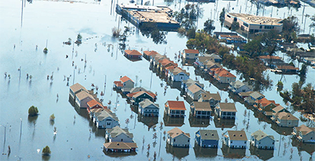 Aerial view of houses partially submerged in flood water from Hurricane Katrina.