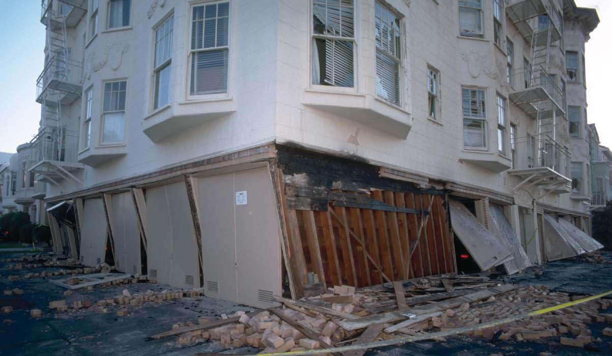 A building that collapsed at the point where the ground floor support was weak.