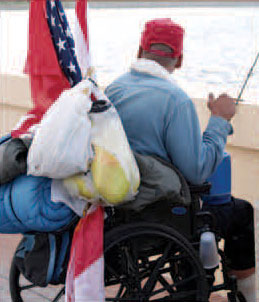 A picture of a disabled homeless veteran in a wheelchair.