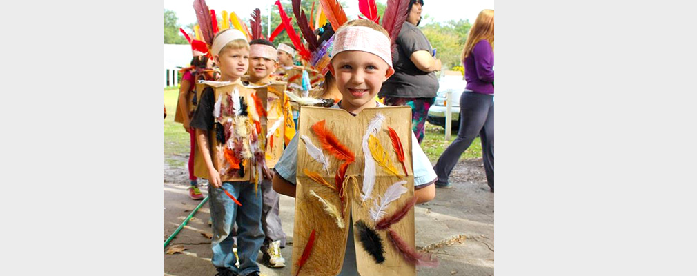 Photograph of six young students dressed as Native Americans in costumes they made.
