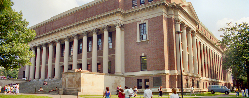 Photograph of two façades of Harvard University's Widener Library, a four-story brick building with a colonnade marking the entrance.