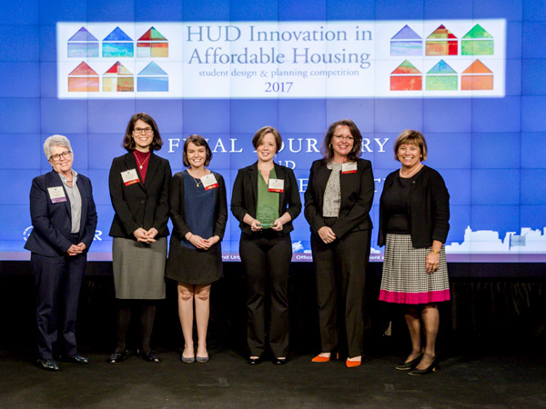 HUD Acting Deputy Secretary Janet Golrick poses with the winners of the 2017 Innovation in Affordable Housing Student Design and Planning Competition.