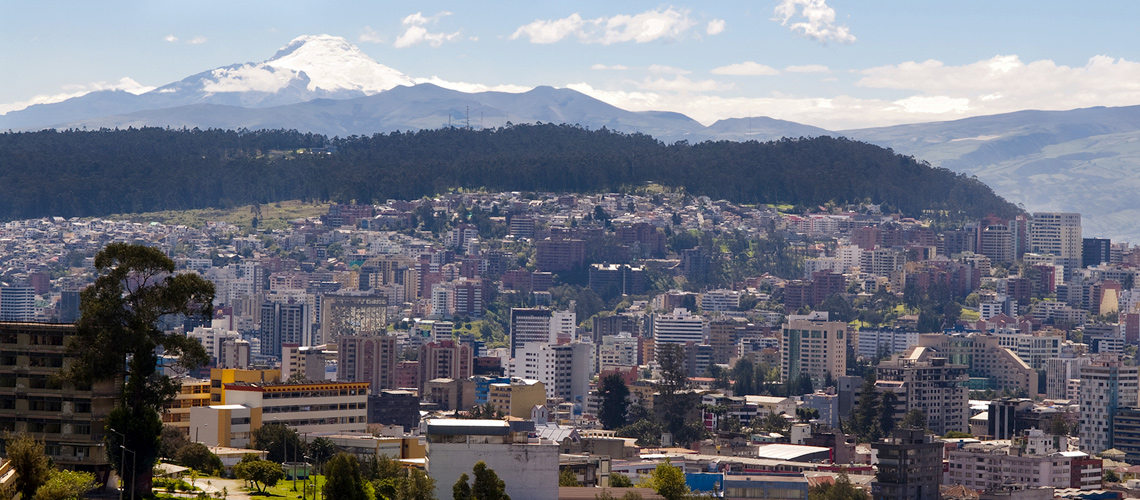 Photograph showing the city of Quito, Ecuador in front of the Pichincha skyline.