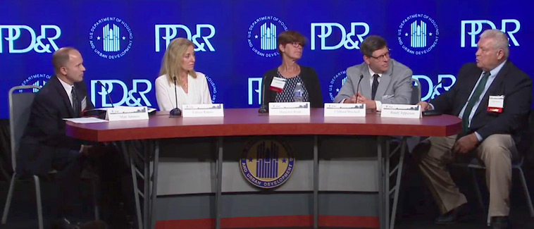 General Deputy Assistant Secretary for PD&R Matt Ammon and four panel participants sit behind a table in front of a background with the PD&R logo.