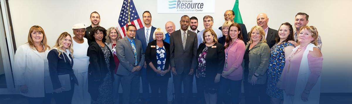Photograph of Secretary Dr. Ben Carson and twenty others at the Spokane Resource Center