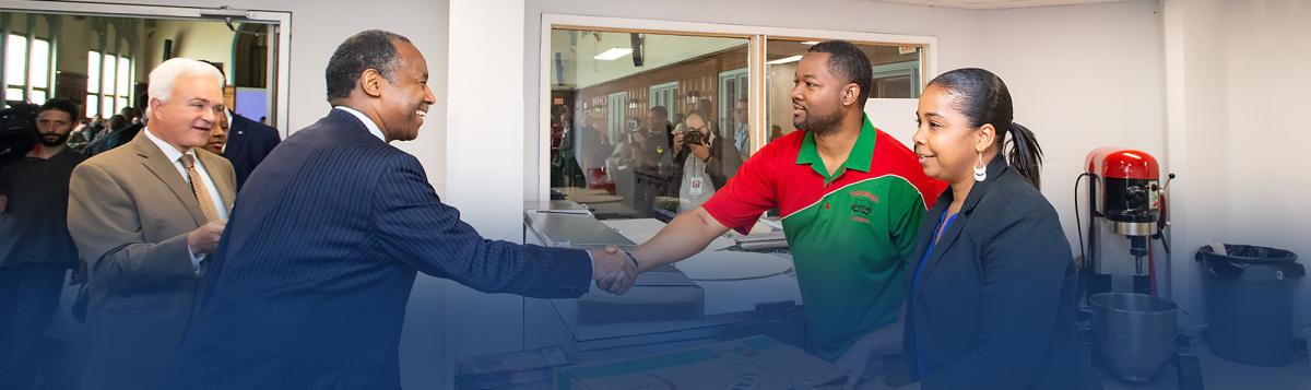 Image of Secretary Dr. Ben Carson touring a mobile food pantry