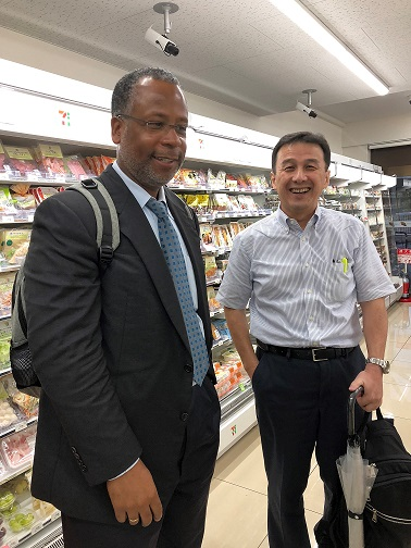 Calvin Johnson and Keiji Kamiyama standing in the aisle of a 7-Eleven store.