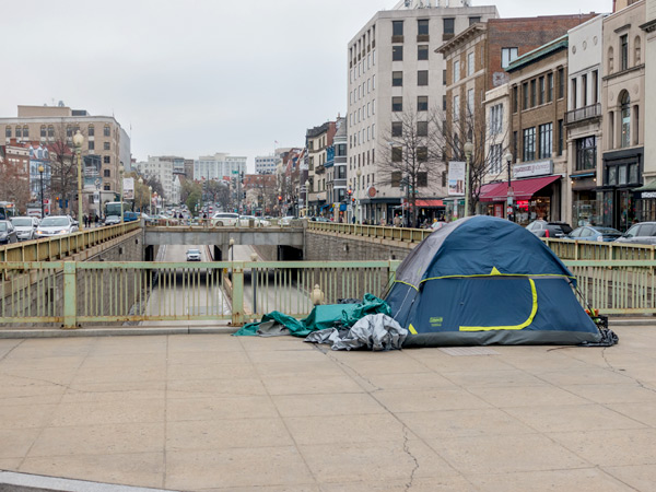 Photograph of a tent on a sidewalk in the Dupont Circle neighborhood of Washington, DC.