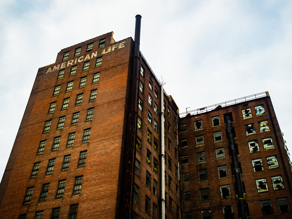 Image of a multi-story brick building.