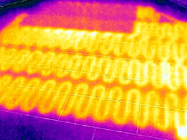 Thermal image of a radiant heating system under a tile floor.