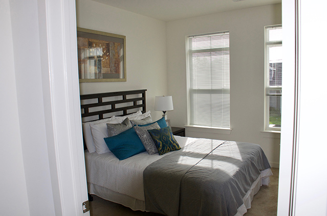 Picture looking into a furnished bedroom.