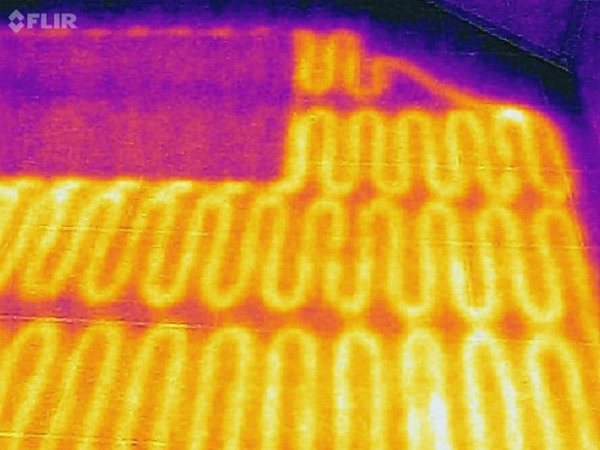 Thermal image of a ceramic floor with electric radiant heating coils visible below.