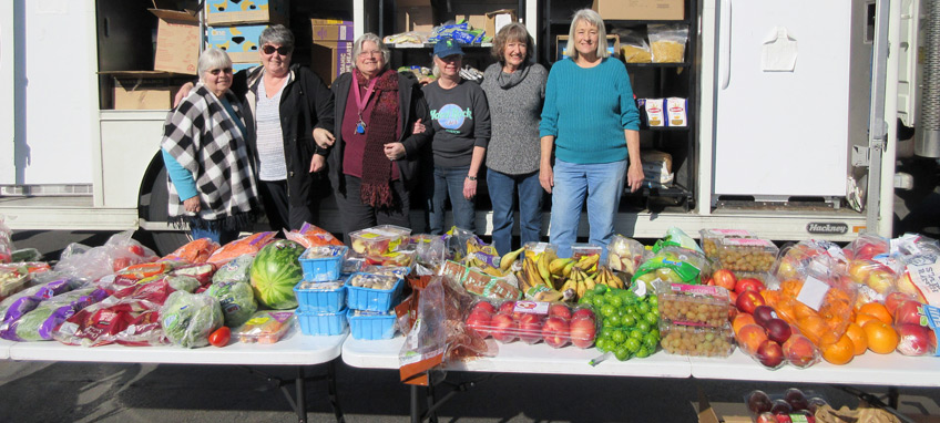 Rogue River Estates resident volunteers are shown in front of the weekly ACCESS Mobile Food Market truck.