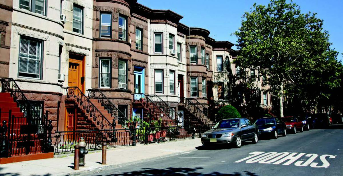 Rowhomes along a street in Brooklyn, New York.