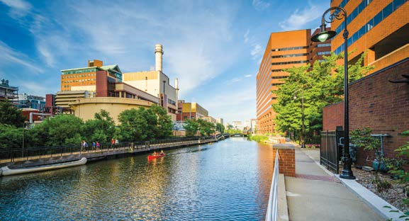 Photo of a man-made canal flanked by high-rise buildings in urban Cambridge, Massachusetts.