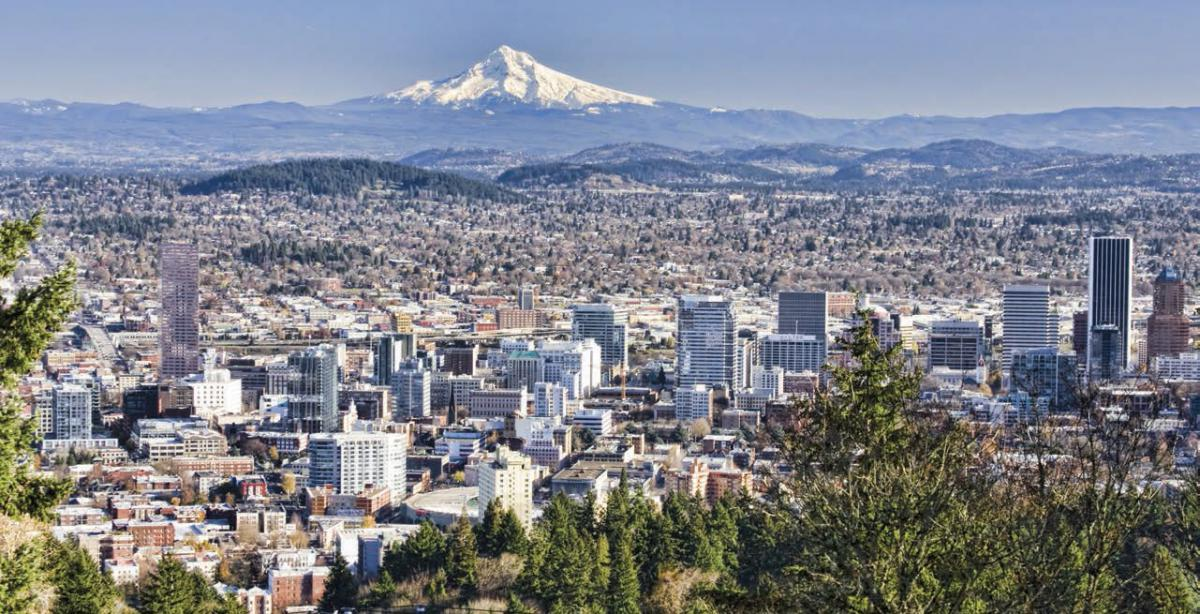 An aerial view of the city of Portland with Mount Hood in the background