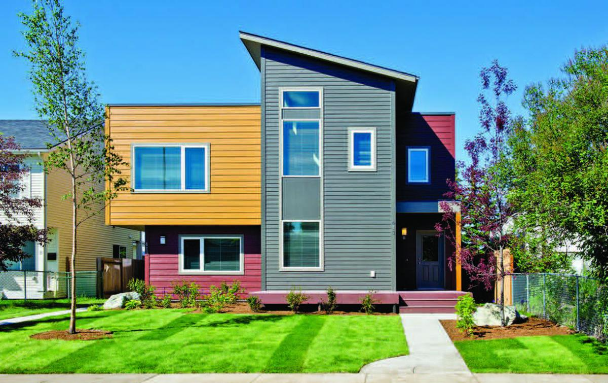 Photo shows a duplex home built using Indian Housing Block Grant funds and Low-Income Housing Tax Credits.