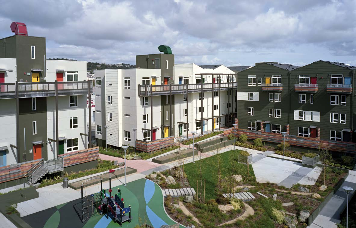Apartment buildings situated around a play area and community garden.